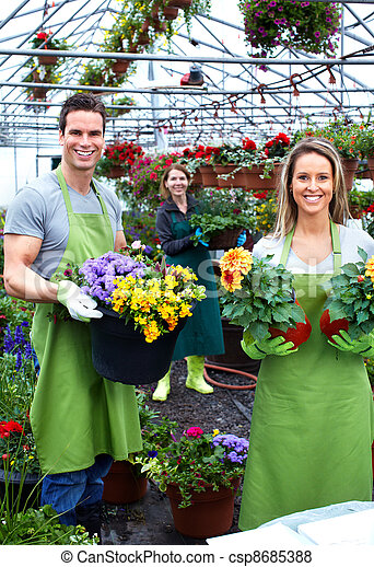 Florists couple working at flower shop. - csp8685388