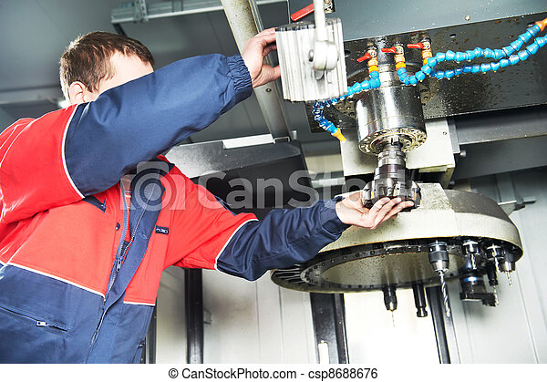 worker operating CNC machine center - csp8688676
