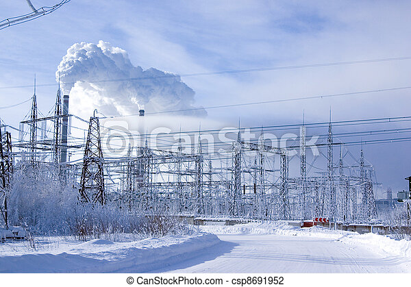Snow-covered road to an environment of trees with smoking pipes on a background - csp8691952