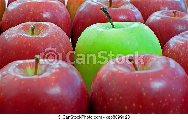 Stock Photography of One of a kind - Single green apple amongst ...