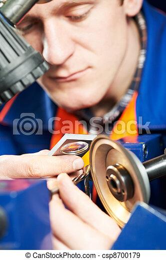 worker measuring detail - csp8700179