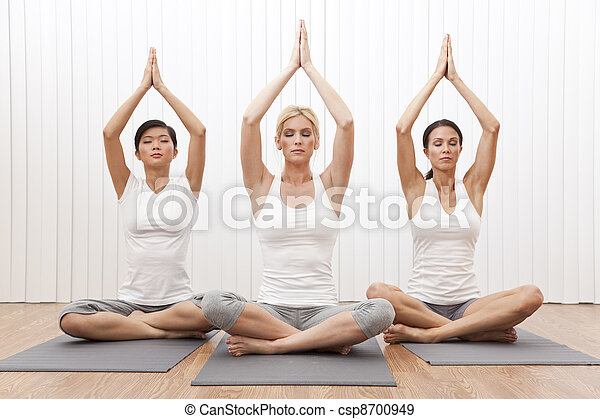 Interracial Group of Three Beautiful Women In Yoga Position - csp8700949