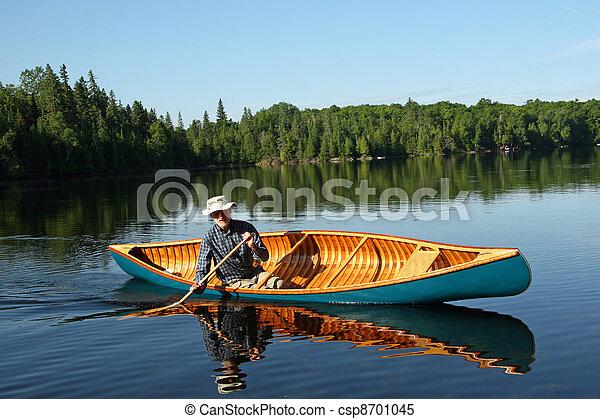 Paddling a canvas cedar canoe - csp8701045