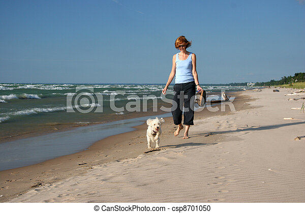 Woman and Dog on a Lake Huron beach - csp8701050
