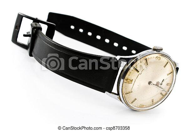 Old broken wristwatch with black strap - csp8703358