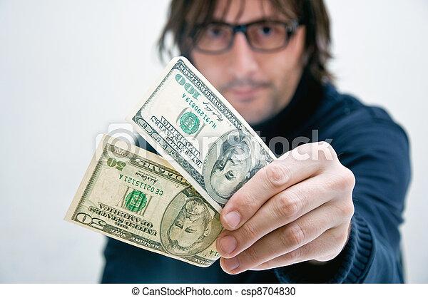 Man paying in dollars - csp8704830