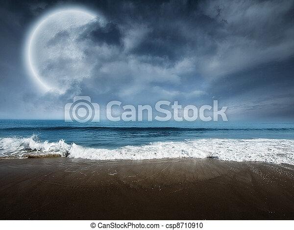 Fantasy beach scene with large moon - csp8710910