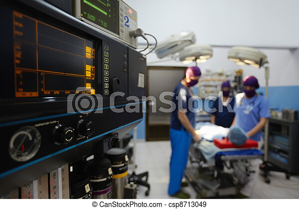 Operation room in clinic with medical staff during surgery - csp8713049