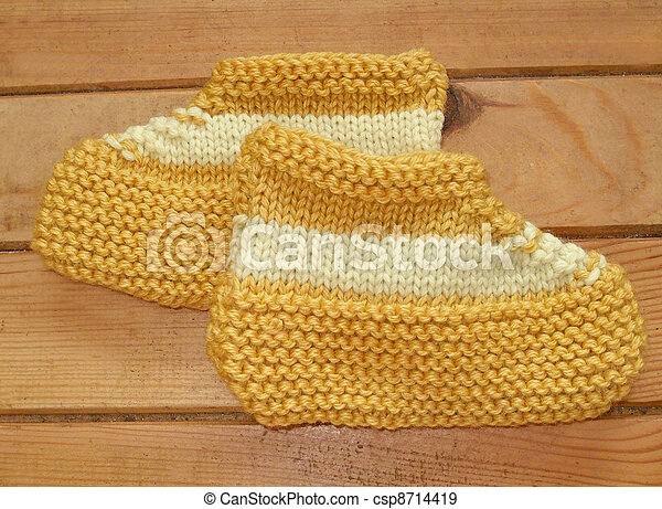 Hand knitted baby booties - csp8714419