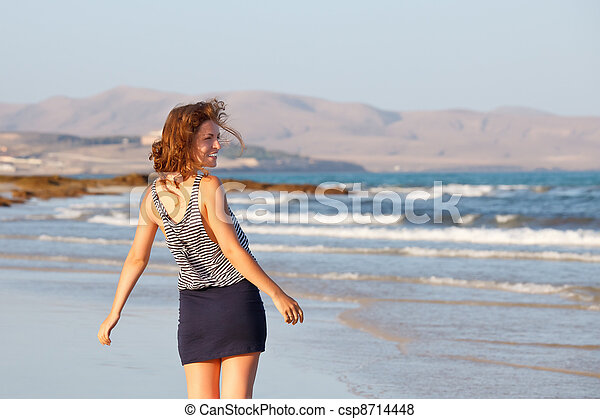 Young woman on a beach - csp8714448