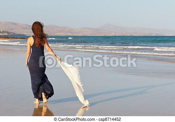 Young woman on a beach - csp8714452