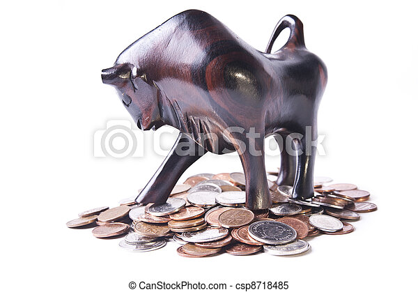 A strong, triumphant bull atop a pile of coins, signifying an optimistic or bullish foreign currency (forex) market. - csp8718485