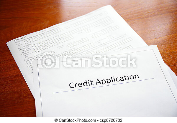 blank credit application form on a desk - csp8720782