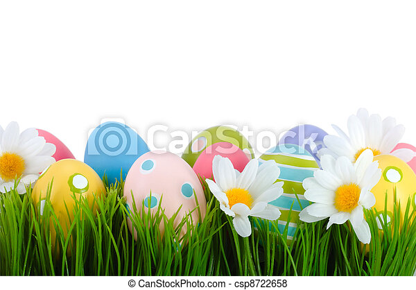 Easter colored eggs on the grass. - csp8722658