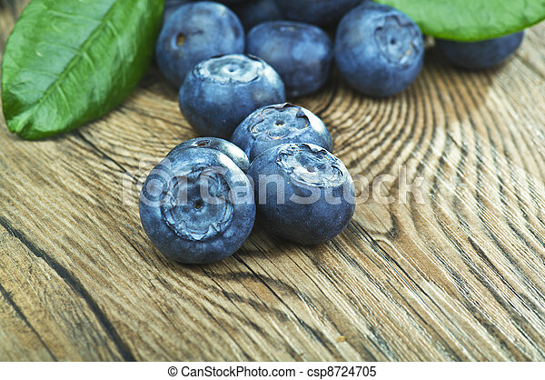 blueberries close up on a wood table