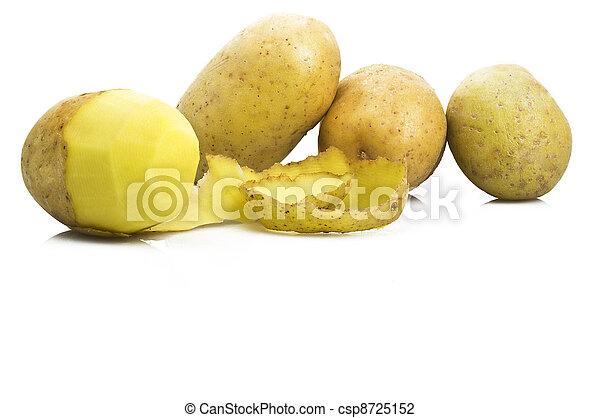 Potatoes with peeled potato on the white - csp8725152