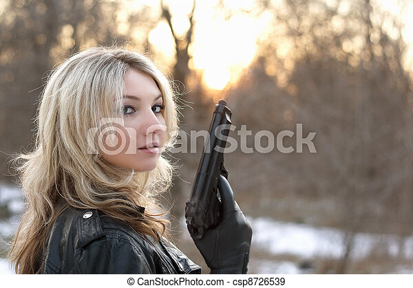 Provocative young woman with a gun - csp8726539