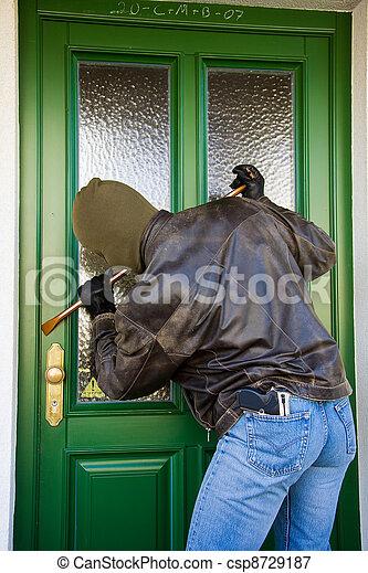 burglars at a house door - csp8729187