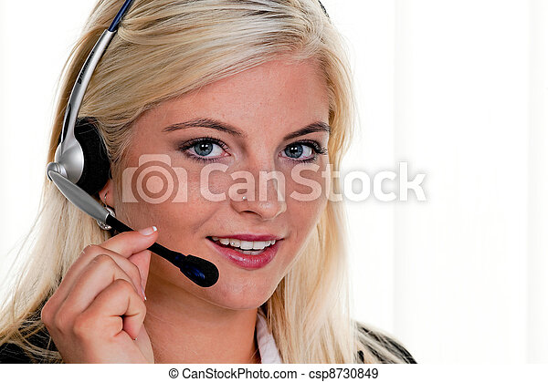 woman with headset and computer - csp8730849