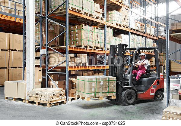 worker driver at warehouse forklift loader works - csp8731625