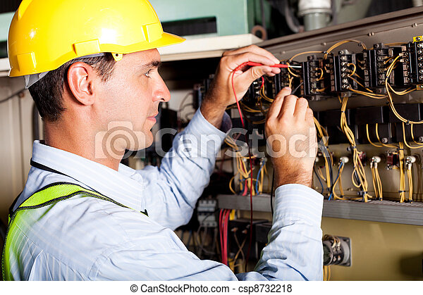 male electrician testing industrial machine - csp8732218