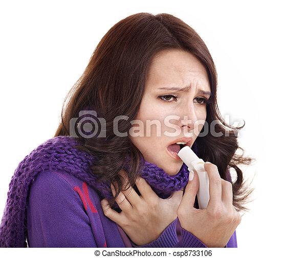 Woman using throat spray. - csp8733106