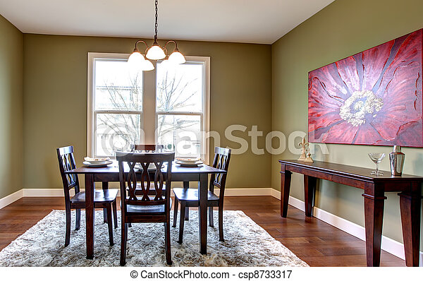 Dining room with green walls and red painting. - csp8733317
