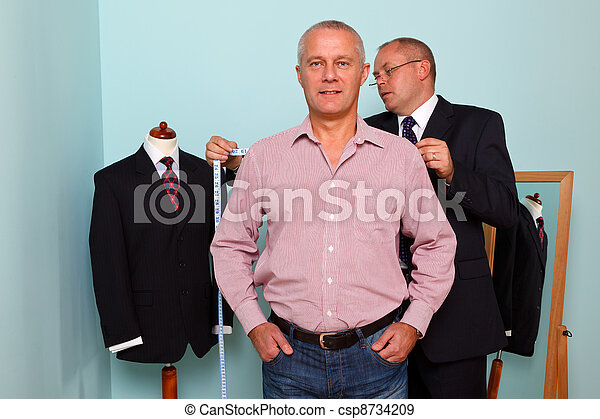 Man being fitted for a bespoke suit - csp8734209