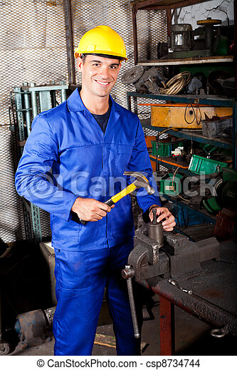 happy blue collar worker working in workshop - csp8734744