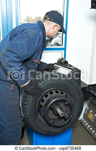 machanic repairman at tyre balancing adjustment - csp8735468