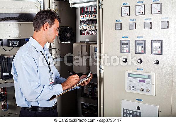 technician writing down machine data - csp8736117