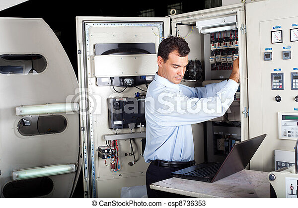 industrial technician repairing machine - csp8736353