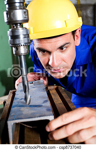 worker using industrial drilling machine - csp8737040