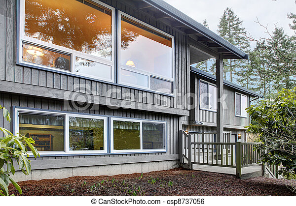 Split level brown grey house front exterior. - csp8737056