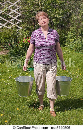 The rural woman with a bucket in hands - csp8740506