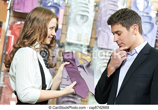 man and assistant at apparel clothes shopping - csp8742669
