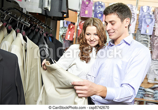 Young peoples shopping at clothes store - csp8742670
