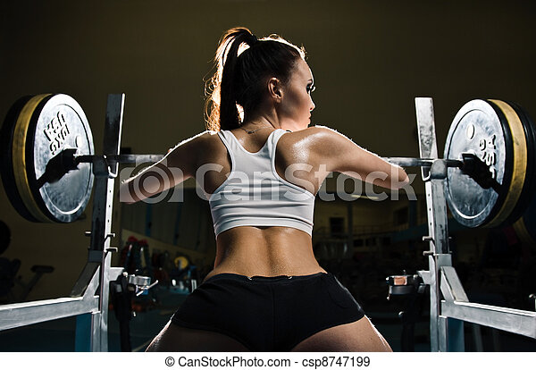 Sporty sexy woman in gym - csp8747199