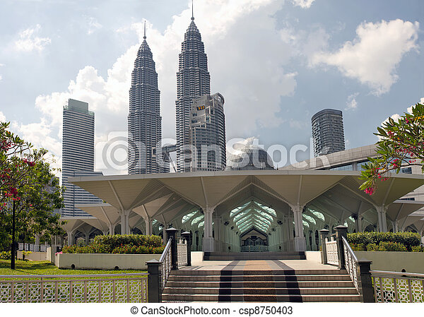 Masjid Asy-Syakirin Muslim Mosque in Kuala Lumpur City Center Park  with Downtown Skyline Malaysia - csp8750403