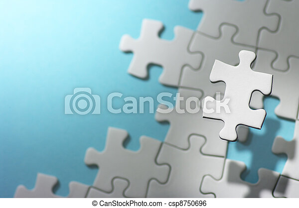 Floating jigsaw puzzle piece in spot light. - csp8750696