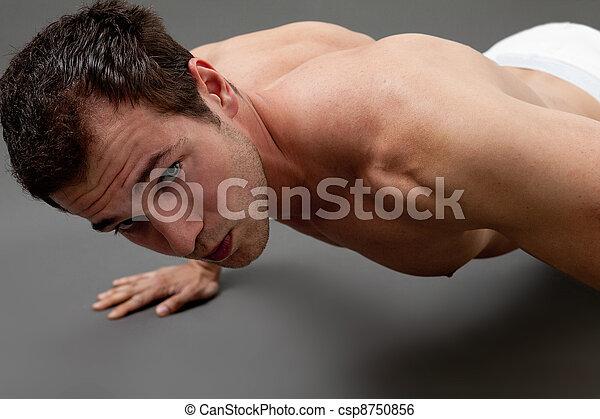 Sexy muscular man doing fitness - csp8750856