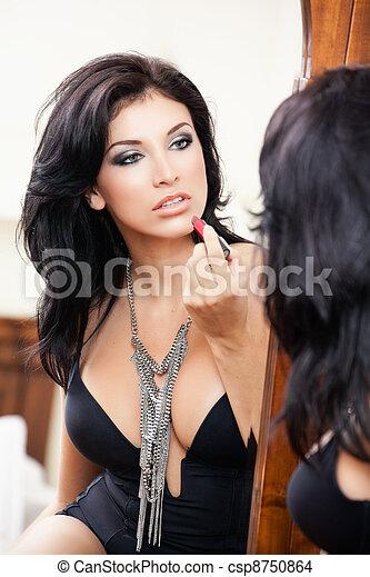 Sexy sensual woman applying lipstick - csp8750864