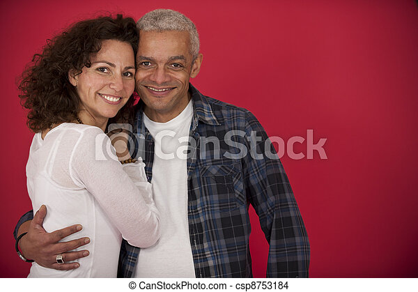 portrait of a mid adult couple hugging - csp8753184