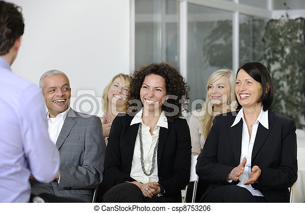 Business team listening smiling to speaker - csp8753206