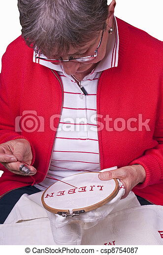 pensioner does embroidery - csp8754087