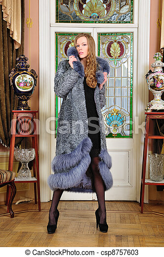 Portrait of the beautiful woman in fur coat. The luxurious classical interior. - csp8757603