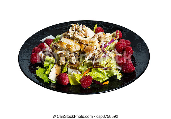 Raspberry chicken salad on black plate - csp8758592