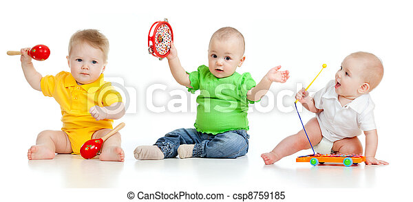 Children playing with musical toys. Isolated on white background - csp8759185