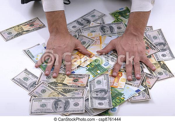 Business man holding money - csp8761444
