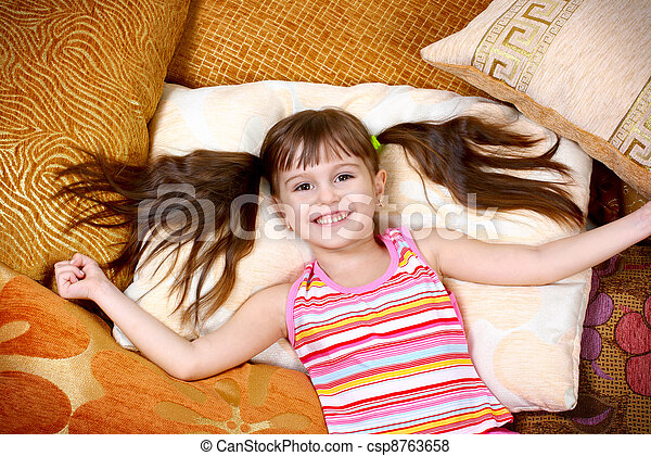 happy child girl resting on soft pillow - csp8763658